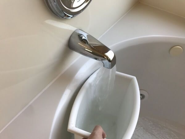 Use hot water to un clog drain in toilet