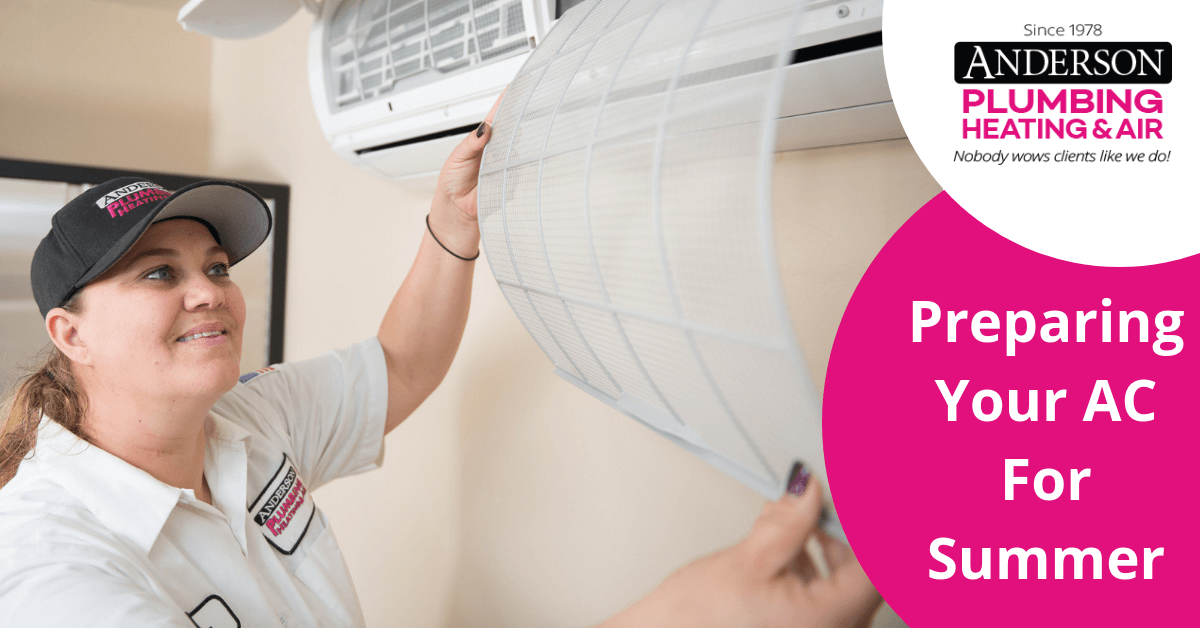 Anderson AC repair technician replacing an air conditioning filter