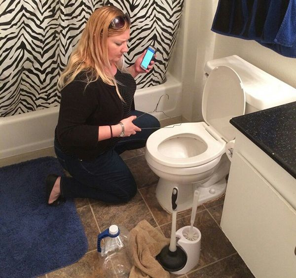 Woman who needs professional drain cleaner