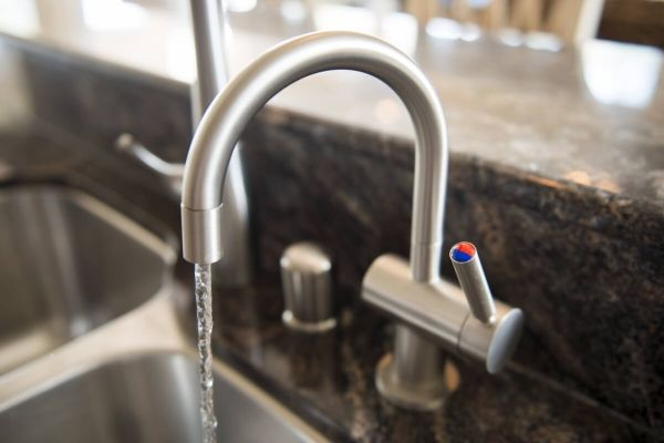 Run cold water in the kitchen sink to avoid a drain problem